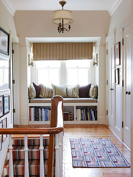 a windowsill reading nook with an upholstered bench and some built-in shelves under it looks cute and cozy