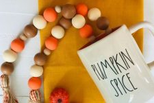 a wooden bead Thanksgiving garland in fall colors with twine and plaid ribbons is also goof for the fall