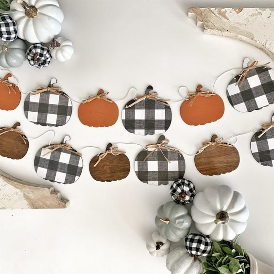 plywood pumpkin garlands in orange, plaid and stain are stylish to decorate your space for the fall and Thanksgiving