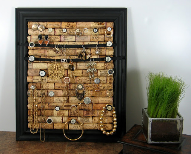 simple yet very orginal jewelry display made of a picture frame and wine corks