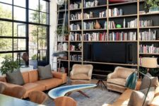 a large dark built-in bookcase done in black and light-colored wood looks bold and statement-like