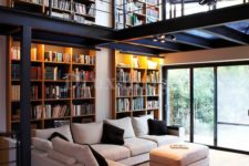 a whole two-level library embracing both the living room and home office looks wow