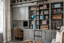 an oversized grey bookcase with closed and open storage compartments is an elegant and refined idea