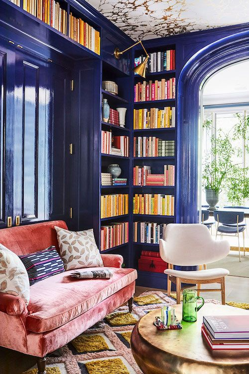 bright blue lacquered bookcases built into the walls are a great idea to make the space bright and to store books