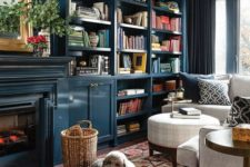built-in bookshelves right in the teal wall are a nice idea for a contemporary space, they add a moody feel