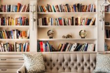 elegant and refined built-in bookshelves with molding look nice and chic and make the space more library-like