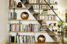 open shelves and an airy staircase make a cool modern combo and you can easily store all the books you want