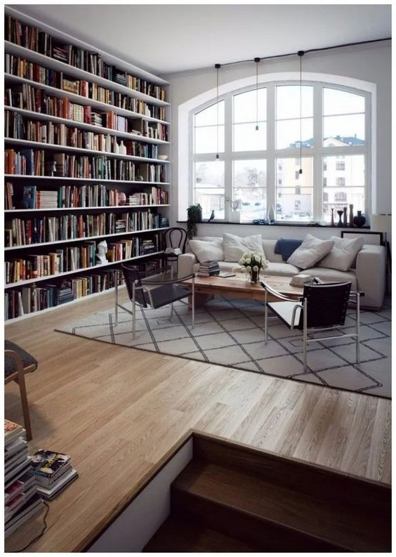 open shelves next to the sofa take a whole wall and give enough space to store, this is a library living room