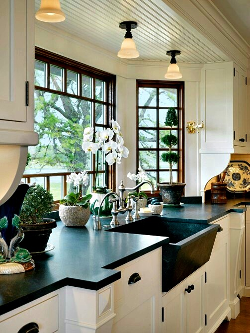 The natural light coming from bay windows could make your cooking process much cooler.