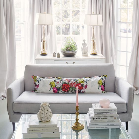 Gray curtains and a gray sofa is a great choice when you don't want to turn a bay window into a focal point.