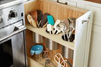 DIY pull-out utensil bin right next to the stove, is a clever alternative to the traditional corner-cabinet