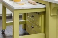 a pull-out table on wheels can make a kitchen island even more functional than it already is
