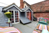 big colourful floor cushions are a versatile addition to any home and garden because can be picked up and moved easily