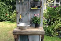 potting station made of an old door and other salvaged items
