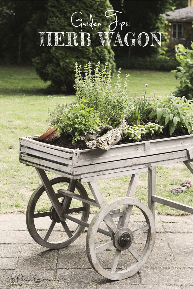 A vintage wagon is an awesome container for a large outdoor herb garden that can be moved.