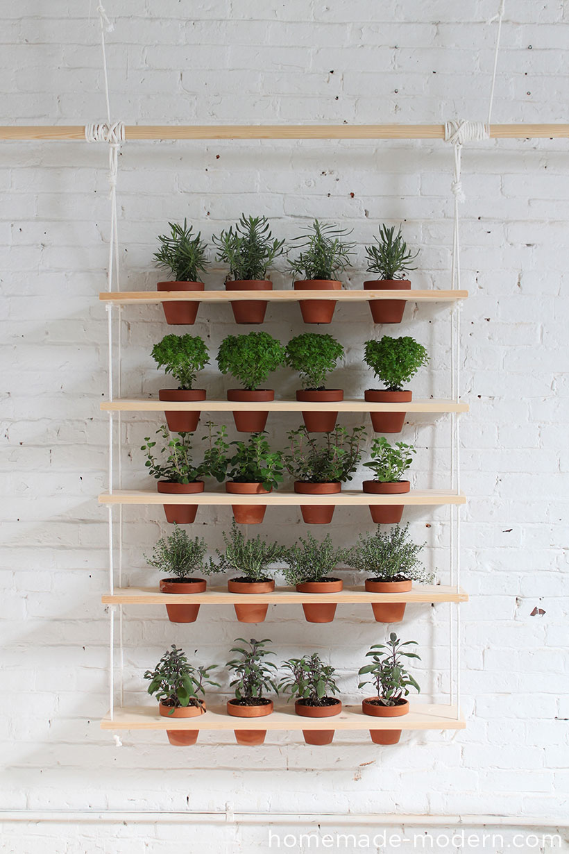 Hanging herb garden ideas always amaze me. In this case   it's a great addition to a modern interior.