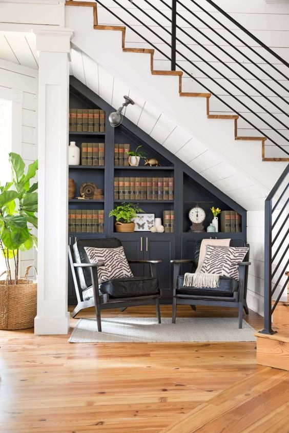 a dark built-in bookcase and a couple of dark chairs to form a reading nook easily and without taking much space