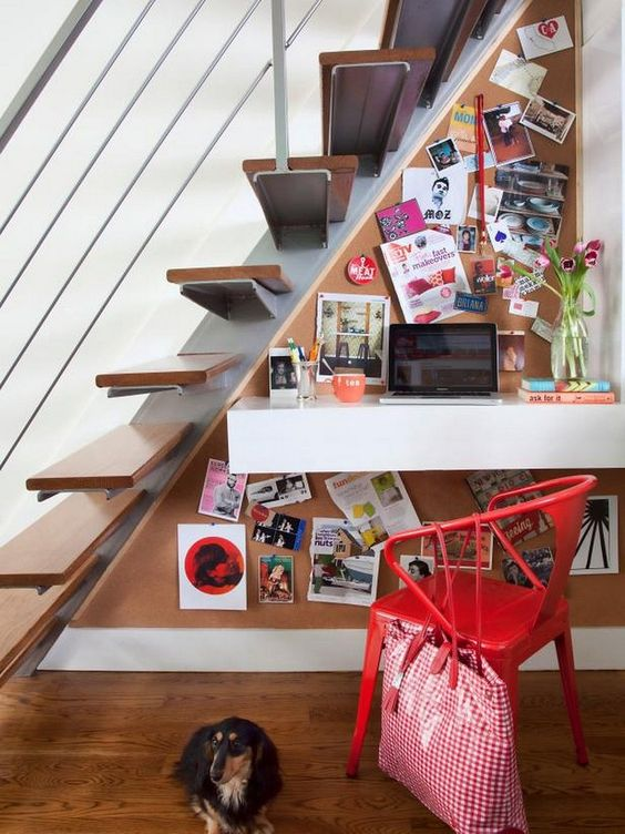 a floating drawer desk, a corkboard and a chair for a little and colorful work nook under the stairs