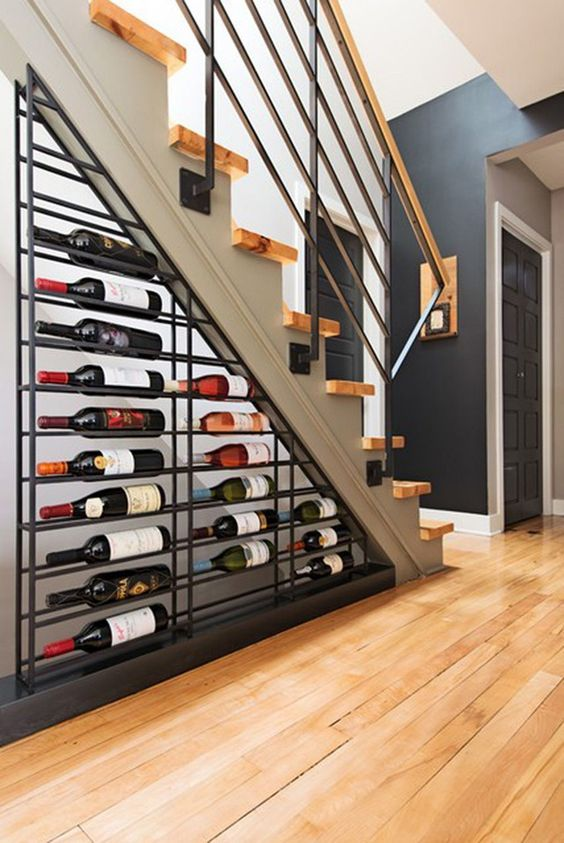 a large metal wine shelf under the stairs is a cool idea to rock in any living room - your little wine nook is here