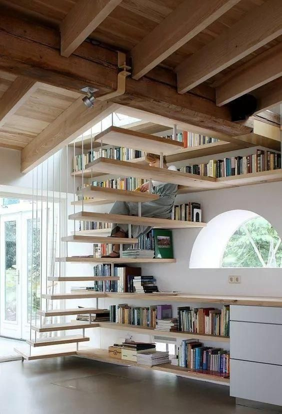 a semi circle window, some drawers and open shelving that also forms steps of the staircase