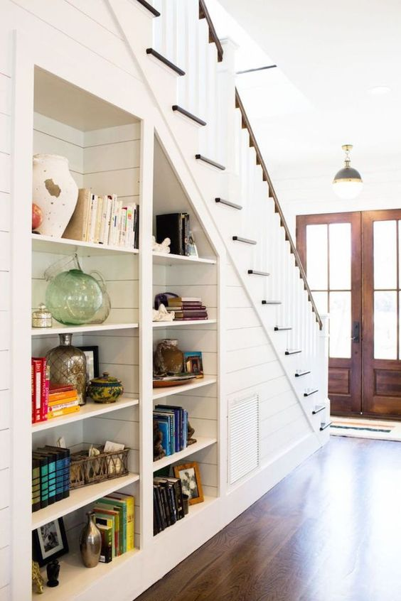 built-in open shelves under the stairs are nice to get more storage space without sacrificing floor space