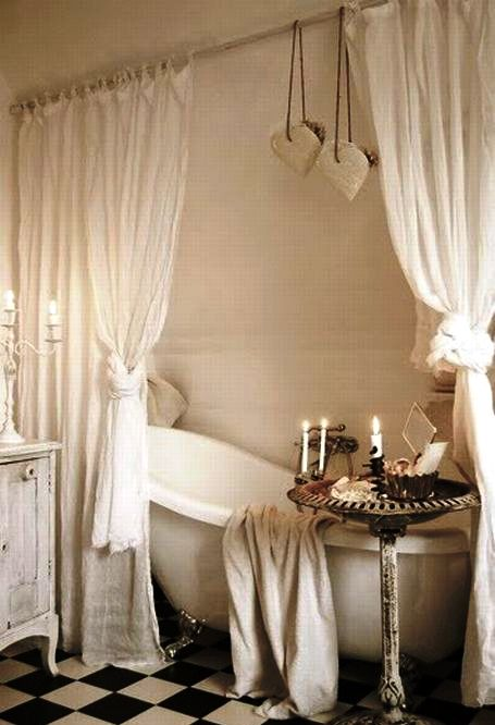 curtains, distressed washbasin and an awesome bathtub...you don't need more for cozy shabby chic bathroom
