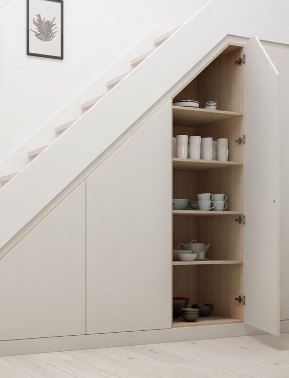 sleek hidden storage spaces with tableware are a great idea if you don't have enough space in the kitchen