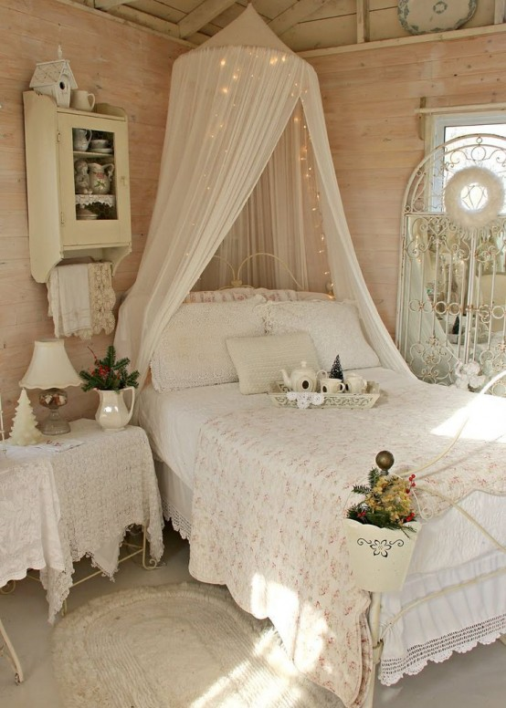 Perfect sweet shabby chic bedroom with a canopy bed