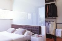 clever solution for a walk in closet behind a bed