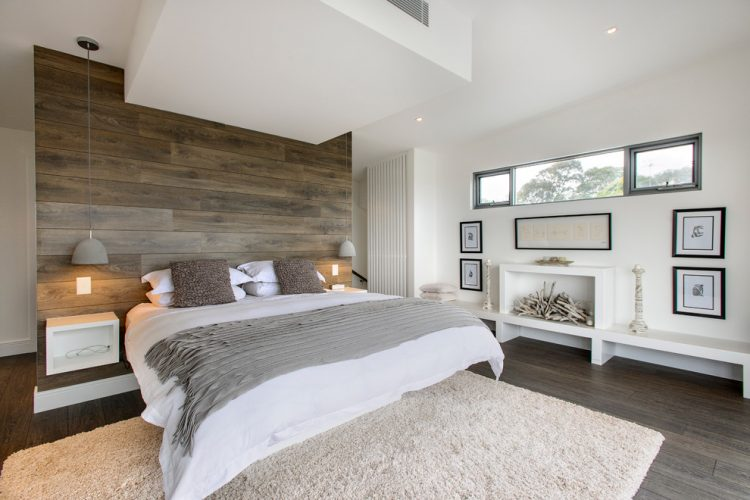 covering a wall behind a bed with rustic laminate boards could add an intersting touch to a bedrooms design