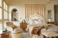 curtain behind a bed could hide a secret nook behind it