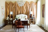 draped wall behind a bed makes this bedroom look quite bohemian