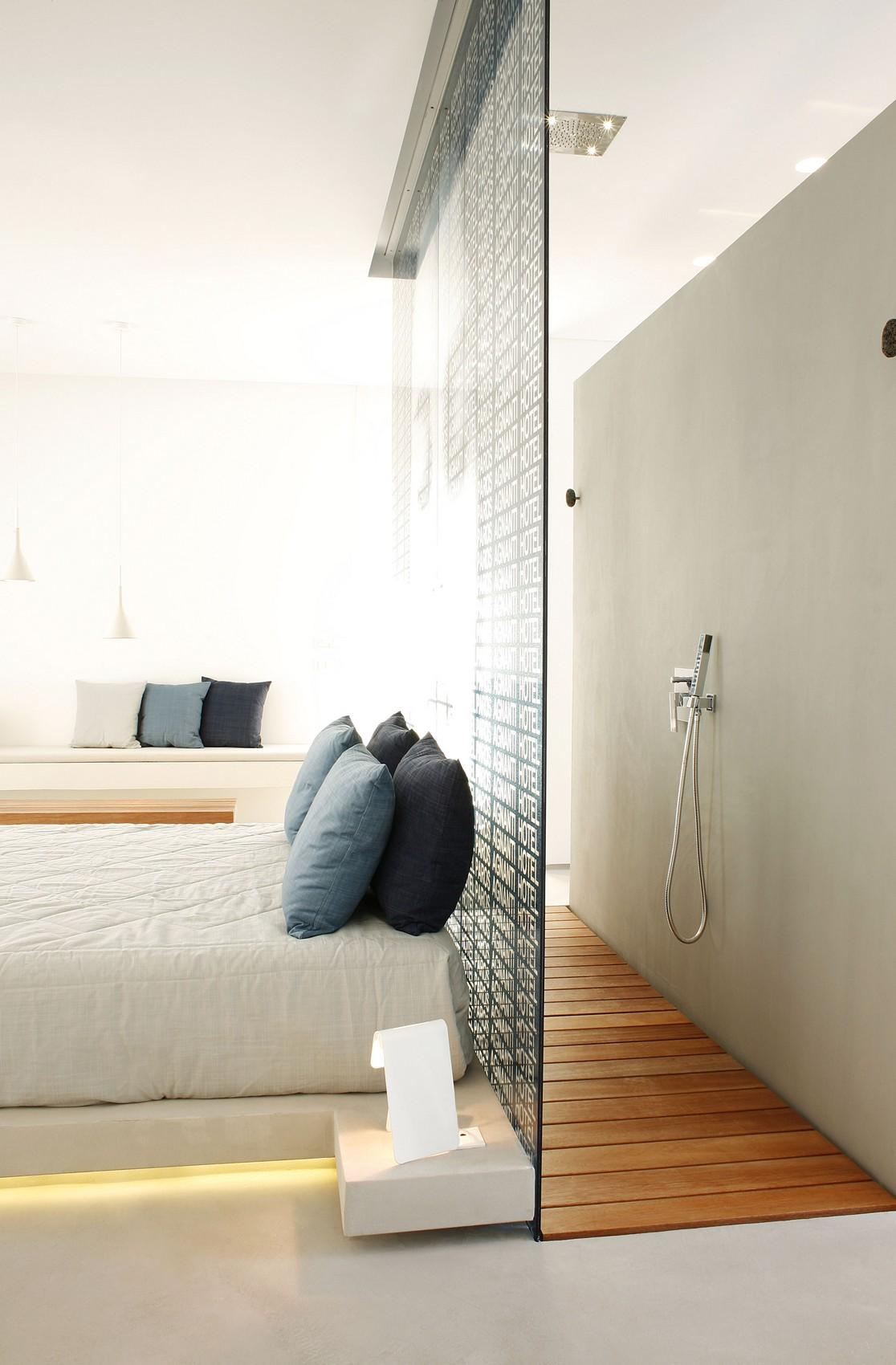walk in shower could be placed right behind a bed