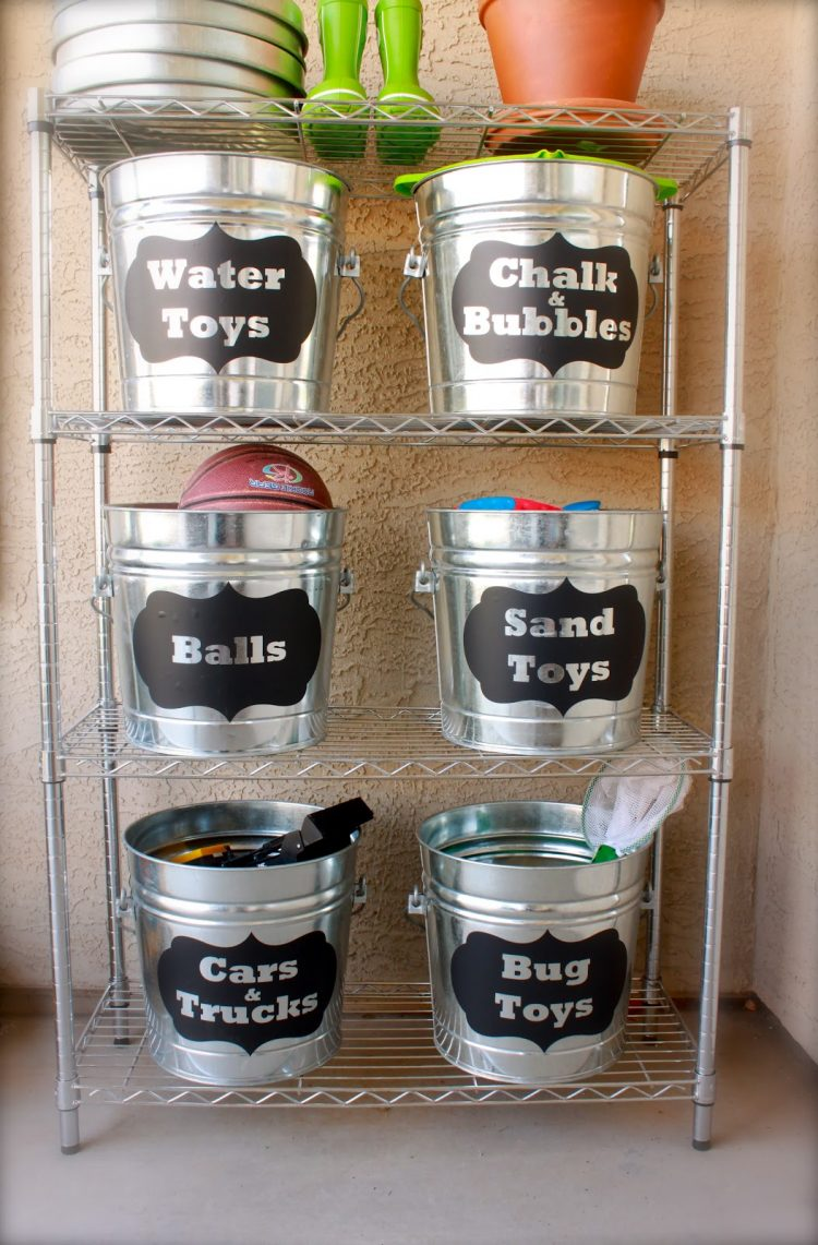 If there is a lot of toys scattered all over the yard you might need a storage solution for them. Simple buckets with chalkboard labels are perfect for the task. (via domesticcharm)