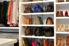 a chic open cabinet with glass partitions to store bags and clutches of various sizes, totes down and larger bags up
