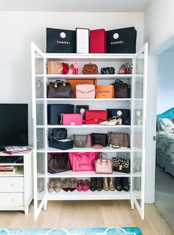 a glass armoire is a gorgeous way to store and display your designer bags and shoes, they will become part of home decor