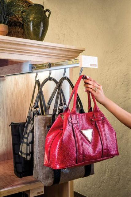 a gliding holder for the bags can give yousome hooks for hanging or can be hidden away when not in need