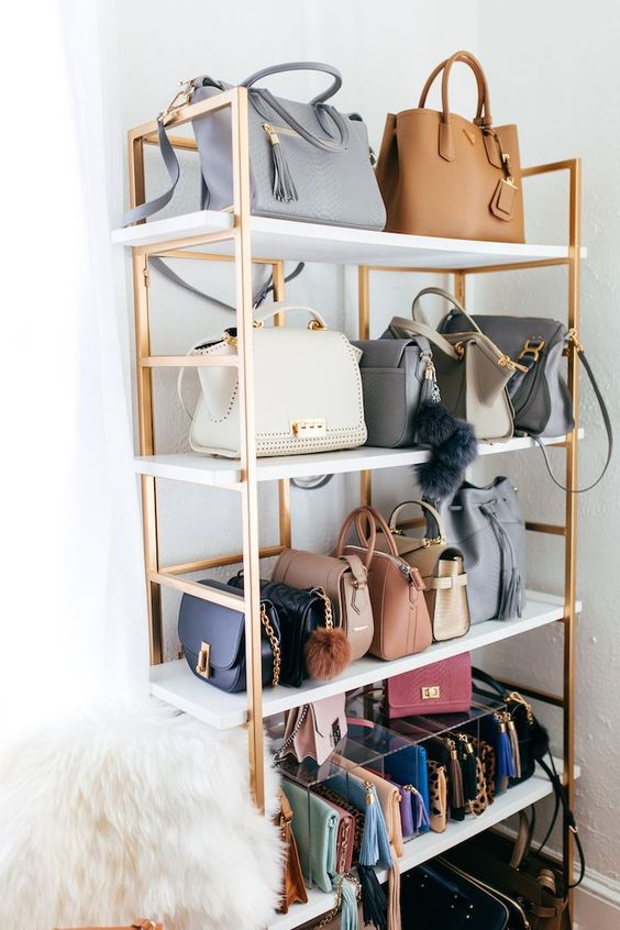 a stylish glam open rack on casters for holding your precious bags is a gorgeous idea for a bedroom or a closet and it cna hold all the types of them