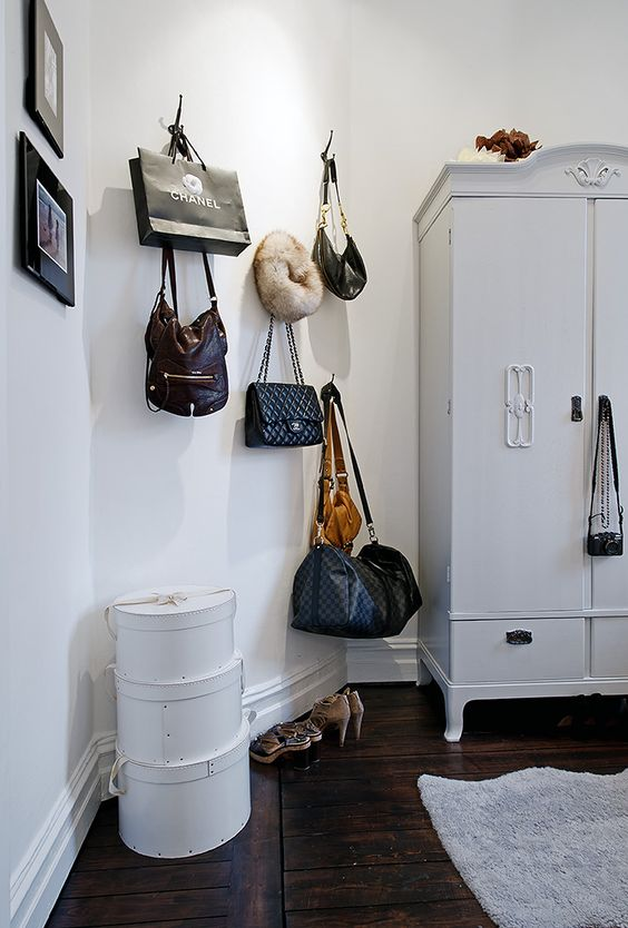 a wardrobe plus some usual hooks on the wall to hold your bags and paper bags, too