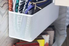 attach such mesh containers to your closet doors and all your purses, handbags and clutches will fit there