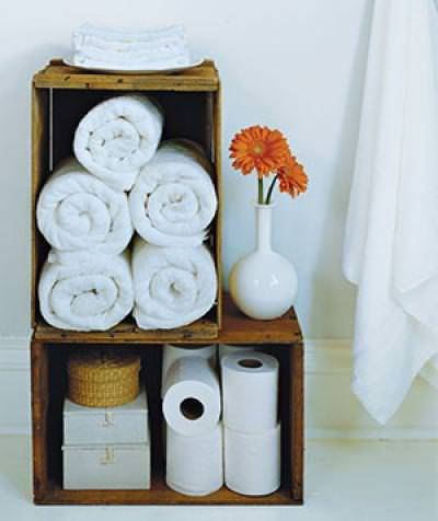 Wine crates could be used to store toilet paper, towels and other things