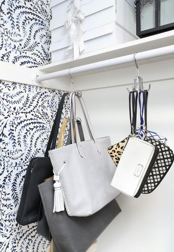 simple metal hooks in your closet or on some rails will hold all the bags that have any kind of handles