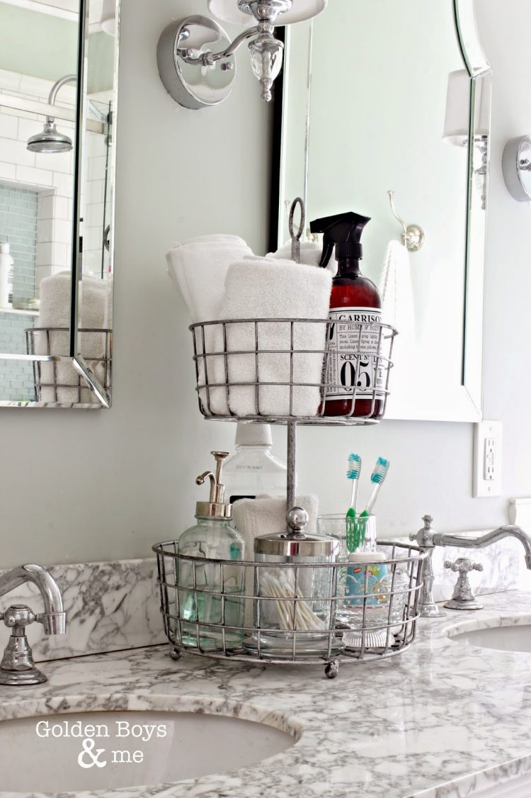 Metal baskets to organize toothbrushes on a washbasin