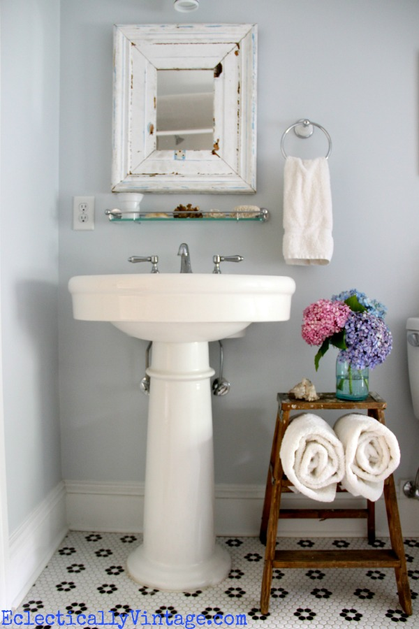 Vintage ladder can add an awesome touch and provide some storage in any bathroom