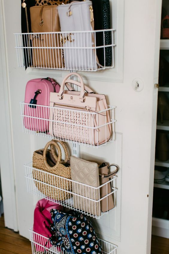 wire baskets attached to a closet door is a great idea to store smaller bags and clutches and they look pretty in there