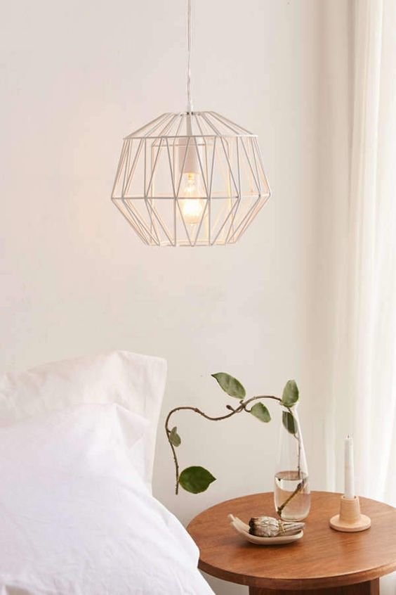 a catchy geometric wire pendant lamp with a bulb is a stylish idea for a contemporary bedroom