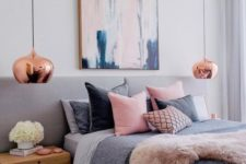 a feminine bedroom with touches of pink and cute copper pendant lamps for a chic look