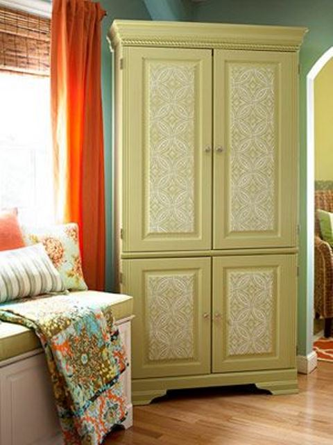 a green vintage wardrobe stenciled with white paint looks pretty and very cool