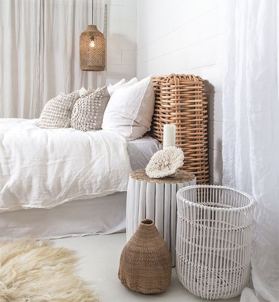 a wicker pendant lamp echoes with the same headboard and accessories make the bedroom feel more rustic