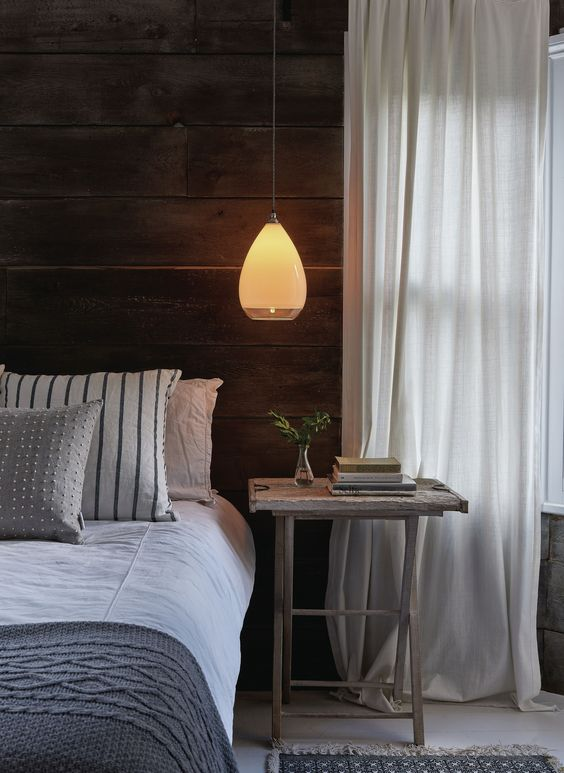 an elegant frosted glass pendant lamp with a sheer edge is a stylish idea for a contemporary bedroom